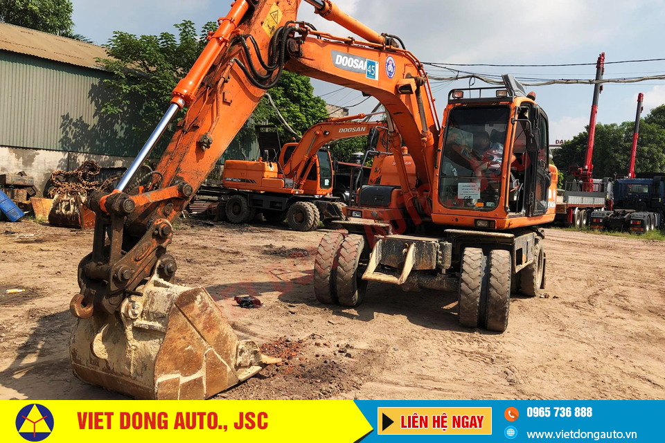 may-xuc-dao-doosan-dx140wa-banh-lop-2011